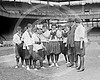 Female baseball players and Clark Griffith, owner and manager Washington Senators AL,  10 June 1920.