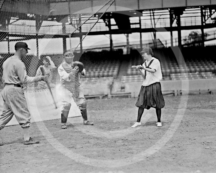 Female baseball  player and Washington Senators AL players, 10 June 1920.