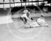 Female baseball player, Ardis Yelton is shown the proper way to slide into a base by a Washington Senators AL, 10 June 1920.
