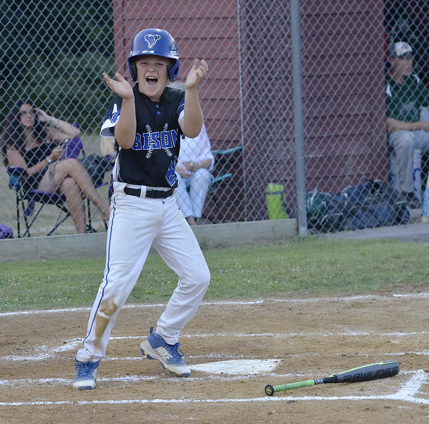 STAN HUDY - SHUDY@DIGITALFIRSTMEDIA.COM<br /> North Colonie Cal Ripken 11U base runner Frank Conroy celebrates his run as he looks into the Bison dugout Monday night during the Eastern NY State championship game.