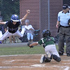 STAN HUDY - SHUDY@DIGITALFIRSTMEDIA.COM<br /> North Colonie Bison base runner Nate Maron goes airborne while attempting to avoid the tag by Clifton Park catcherBrad Curtis in the Cal Ripken 11U Eastern NY State championship game Monday night.