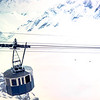 """Thye Zugspitze where you can ski from early Oct. to late April. The cable car goes from the mountain top down to the hotel in the Zugspitze."" Germany 1968"