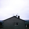 """That's a romantic chimneysweep on our neighbor's roof."" Simmershausen, Germany, 1968"