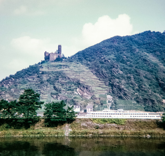 """Cat Castle on Mouse Mountain. In the foreground is a luxery tour boat."", Rhine River, Germany, 1968"