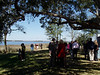 Guests gather on the banks of the Ashley River