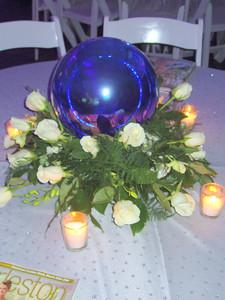 """With our """"Under the Charleston Stars"""" theme, we used all things that glitter and reflected...from gazing balls to broken glass vases and all garden roses."""