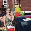 GREG SUKIENNIK -- MANCHESTER JOURNAL<br /> Burr and Burton Academy seniors Jana Spivey, left, and Alyson Webster (with phone) take in the Class of 2020's car parade through the streets of Manchester on May 26, 2020