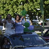 GREG SUKIENNIK -- MANCHESTER JOURNAL<br /> Burr and Burton Academy seniors Kamryn Greene and Izzy Townsend waive to friends as they make their way past campus during the Class of 2020's car parade on May 26, 2020
