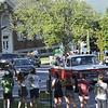 GREG SUKIENNIK -- MANCHESTER JOURNAL<br /> Burr and Burton Academy seniors drive past the school's campus on Seminary Avenue as they finish a car parade through the streets of Manchester on May 26, 2020