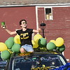 GREG SUKIENNIK -- MANCHESTER JOURNAL<br /> Burr and Burton Academy senior Josi Moser celebrates while taking part in the Class of 2020's car parade through the streets of Manchester on May 26, 2020.