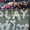 GREG SUKIENNIK -- MANCHESTER JOURNAL<br /> Student fans put up a banner in memory of science teacher Ian Pollock, who died a week ago,  at Saturday's Division 2 championship game.