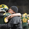 GREG SUKIENNIK -- MANCHESTER JOURNAL<br /> Burr and Burton Academy coach Jason Thomas hugs Jake Baker after BBA's 63-14 win over Fair Haven in the Vermont Division 2 championship game on Saturday, Nov. 10.
