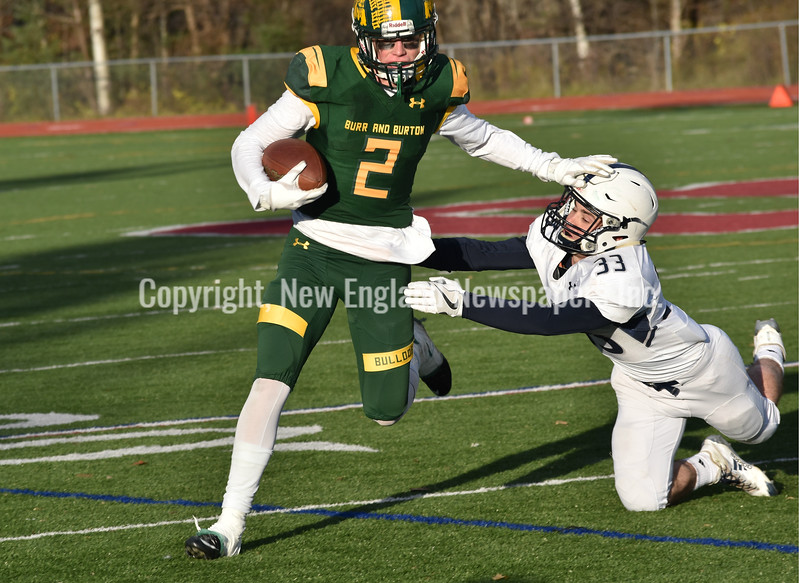 GREG SUKIENNIK -- MANCHESTER JOURNAL<br /> Burr and Burton's Jake Baker stiff-arms Fair Haven's Aaron Szabo on the way to a rushing gain in BBA's 63-14 victory in the Vermont Division 2 championship game on Saturday, Nov. 10.