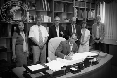 """Guestbook signing in the Rare Book Collection at The National Academic Library of Kazakhstan as part of the seminar """"The Linnaeus Apostles Bridge Builder Expeditions - Sweden, Kazakhstan, Kyrgyzstan & Russia. Including Launch of The Explorer's Field Guide""""."""