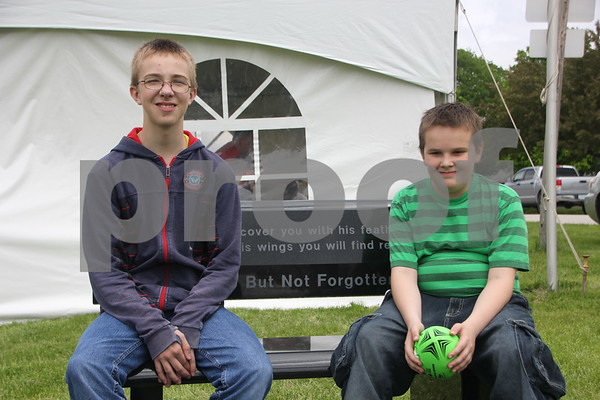 Brock Friday and his brother Toxid Friday are just chilling out  at the BBQ Battle event held May 16, 2015 at the Fort Museum.