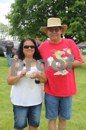 Enjoying the beautiful day at the BBQ Battle event held on May 16, 2015 at the Fort Museum is left to right: Karen White and Ed Byrne.