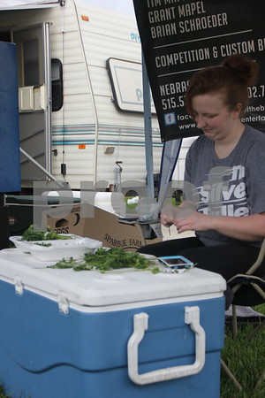 Samantha Aldrich chops vegetables for use in grilling food for the BBQ Battle held at the Fort Museum held on May 16, 2015