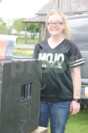 One of the vendors at the recent BBQ Battle event held at the Fort Museum on May 16, 2015 was Mojo Productions. They provided the DJ services. Seen here is Katie Wingert, one of the DJ's .