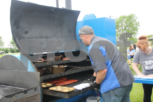 Tim Mapel cooks several items on the grill for the BBQ Battle event held at the Fort Museum on may 16, 2015