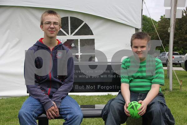 These two brothers are just chilling out at the BBQ Battle  event held on May 16, 2015 at the Fort Museum. Their names are left to right: Brock Friday and his brother Toxid Friday.