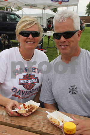 Pictured  from left to right is : Amy Kuns from  the Eagle Grove area and Keith Bryhne sampling the food offered at the BBQ Battle event  at the Fort Museum on May 16, 2015