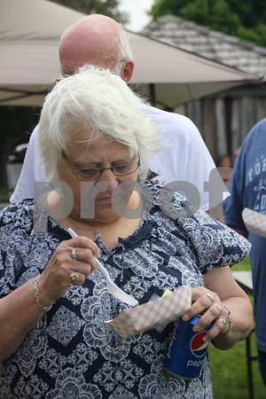 Julie Schultz enjoys  a sample of  the BBQ'd food at the BBQ Battle event held at the Fort Museum on May 16, 2015