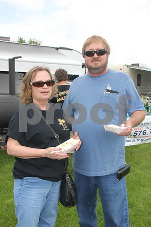 Pictured left to right is : Barb Cory, and Marty Larson as they are  sampling the food at the BBQ Battle event at the Fort Museum held on May 16, 2015