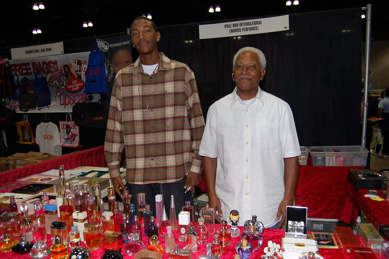 A special vendor, the young man at left assists his grandfather in marketing fragrances at the Expo.  The young man, Corey Brim, is my student at West L.A. College! <br /> <br /> Photo by Isidra Person-Lynn