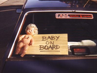 "Not only does he have a twisted enough sense of humour (like mine) to go ahead and mount a baby doll on a board and display it in his car window... he can sing the harmony to the song ""Baby On Board"" from the Simpsons (as performed by Homer's short-lived barbershop quartet, the B Sharps)!"