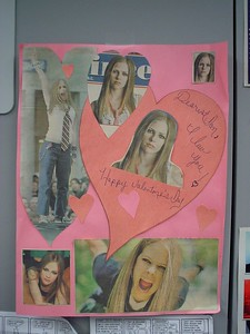 Oh yeah-- his real girlfriend is Avril. So I bought him her new CD the day it was relaeased. Me and Avril can share. This valentine, made by his friends--complete with loopy girlie handwriting-- now adorns his office. And it shall remain so for evermore...