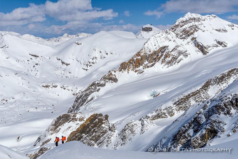 Skiers on Grindle Peak