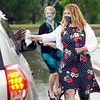 BEN GARVER — THE BERKSHIRE EAGLE<br /> Amanda Osgood, BSN (foreground), and Denise Talabach, BSN, hand pins and flowers to practical Nursing graduates at Berkshire Community College. <br /> Tuesday, June 30. 2020.