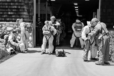 004 Max Burke 2 Smoke Jumpers checking equipment before a jump AS