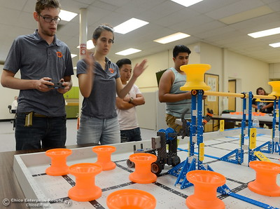Jacob De Necorhea left and Brittany Coito compete with their robot as BCOE representatives compete with newly purchased robots as they learn how things work before teaching students how to use them during this coming school year Friday Aug. 3, 2018.  (Bill Husa -- Enterprise-Record)