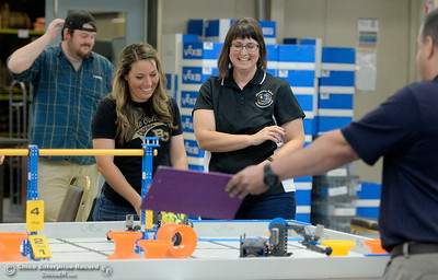 Keri Smith and Jennifer Lasell left to right, smile as they compete with other BCOE representatives with newly purchased robots as they learn how things work before teaching students how to use them during this coming school year Friday Aug. 3, 2018.  (Bill Husa -- Enterprise-Record)