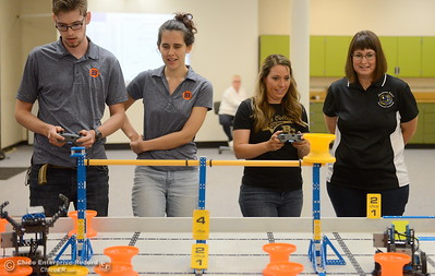 Left to right, Jacob De Necorhea, Brittany Coito, Keri Smith and Jennifer Lasell compete along with other BCOE representatives with newly purchased robots as they learn how things work before teaching students how to use them during this coming school year Friday Aug. 3, 2018.  (Bill Husa -- Enterprise-Record)