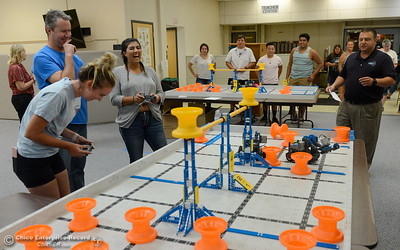 BCOE representatives Kendahl Costa, Graham Greer and Rhiannon Mahnke left to right laugh as they compete with newly purchased robots as they learn how things work before teaching students how to use them during this coming school year Friday Aug. 3, 2018.  (Bill Husa -- Enterprise-Record)