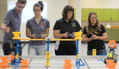 Left to right, Jacob De Necorhea, Brittany Coito, Jennifer Lasell and Keri Smith compete along with other BCOE representatives with newly purchased robots as they learn how things work before teaching students how to use them during this coming school year Friday Aug. 3, 2018.  (Bill Husa -- Enterprise-Record)