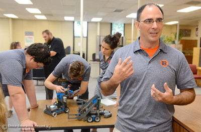 Jonathon Andrew, Executive Director of Inspiration Robotics of Northern California, right, talks about some of the rules associated with the competition as he serves as the Referee while Butte County Office of Education representatives compete with newly purchased robots as they learn how things work before teaching students how to use them during this coming school year Friday Aug. 3, 2018.  (Bill Husa -- Enterprise-Record)