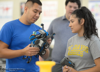 Michael Morfin of Biggs and Kaitlynn Ramos of Gridley fine tune their robot as BCOE representatives compete with newly purchased robots as they learn how things work before teaching students how to use them during this coming school year Friday Aug. 3, 2018.  (Bill Husa -- Enterprise-Record)