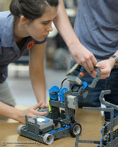 Brittany Coito, left and Jacob De Necorhea work on their bot as BCOE representatives compete with newly purchased robots as they learn how things work before teaching students how to use them during this coming school year Friday Aug. 3, 2018.  (Bill Husa -- Enterprise-Record)