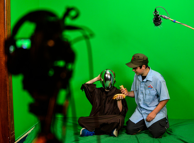 """KRISTOPHER RADDER - BRATTLEBORO REFORMER<br />  On the green screen, Gavin Holloway, playing the """"Death Angel,"""" is encouraged by Adler Pickering to attempt to eat a hotdog without a mouth during the BCTV Video Camp on Wednesday, June 28, 2017."""