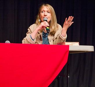 Director Laurie Coyle speaks in the Indoor Theater