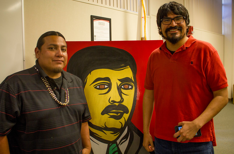 Artist Jorge Guillen and Oliver Rosales pose with Guillen's painting of Ray Gonzales.