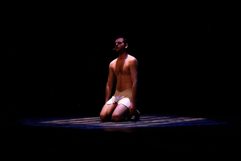 """Joseph (Jake Wattenbarger) alone in his prison cell as he sings """"Close Every Door to Me"""". Photo by Michelle Guerrero."""