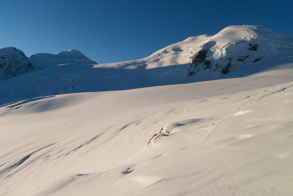While Cherie and I explored the serac maze, Rob and Dan went up to the west ridge of Hochstetter Dome and found a run through some fabulous snow conditions.  They can be just seen returning to the hut in the centre of this shot.