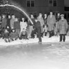 Air Force firemen spray water for rink.jpg
