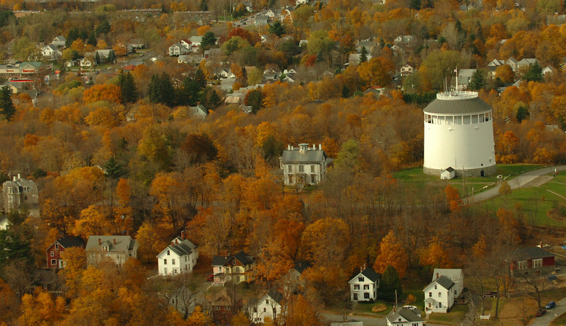 Bangor's 107 year old Thomas Hill Standpipe stands out amoung nearby houses on a recent fall morning.  The structure, designated a national historic landmark holds 750,000 gllons and supplies water to most of the downtown area.  BANGOR DAILY NEWS PHOTO BY KEVIN BENNETT