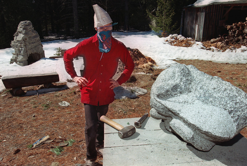 Rick Beckjord surveys his progress carving the eyes in a granite statue of a honeybee. (NEWS Photo by Caleb Raynor)