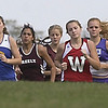 Runners in the Girls State Class B cross country championship meet leave the starting line on Saturday on the 5-kilometer course at the Troy Howard Middle School in Belfast. Hampden Academy captured the state title in 2003. (BANGOR DAILY NEWS PHOTO BY BOB DELONG)